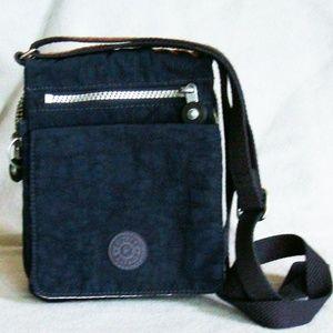 Kipling small navy blue crossbody travel bag